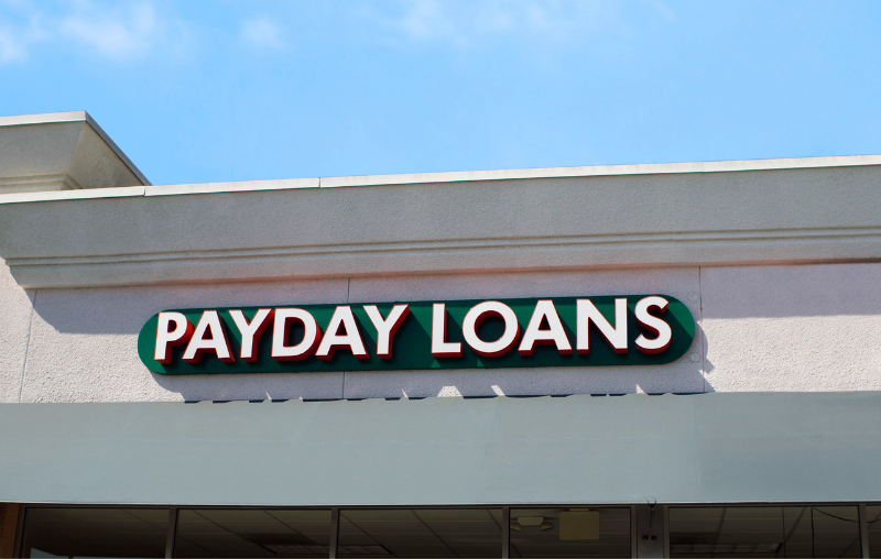 outside building with Payday Loans listed